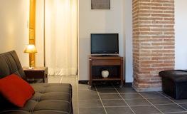 Espace TV du gîte - Domaine de Montcalm